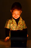 Cute boy smile after opening of a treasure chest Royalty Free Stock Images