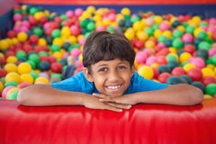 Cute boy smiling in ball pool. At a party Royalty Free Stock Photos