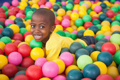 Cute boy smiling in ball pool Royalty Free Stock Photos