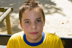 Cute boy smiling at camera in park on a sunny day. Cute boy smiling at camera in the park on a sunny day stock images