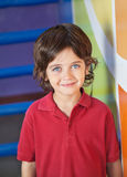 Cute Boy Smiling In Kindergarten royalty free stock images