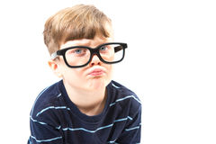 Cute boy smiling with large, goofy glasses Stock Image