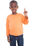 Cute boy smiling and pointing Royalty Free Stock Photography