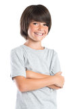 Cute boy smiling. Portrait of a little boy standing with armcrossed. Studio portrait of happy male kid looking at camera. Smiling cute child with grey t-shirt Royalty Free Stock Photo