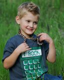 Cute boy and snake Royalty Free Stock Images