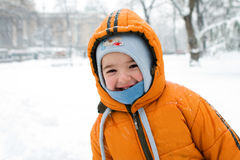 Cute boy in a snowstorm Royalty Free Stock Photography