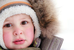 Cute boy in snowsuit Stock Photos