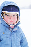 Cute boy in snowsuit Stock Image