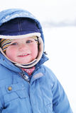 Cute boy in snowsuit Stock Photo