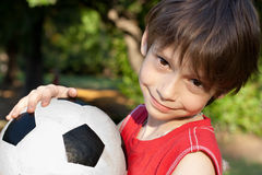 Cute boy with soccer ball Stock Images