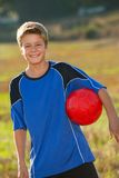 Cute boy with soccer ball outdoors. Royalty Free Stock Photography