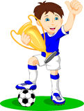 Cute boy soccer player holding gold trophy Royalty Free Stock Photo