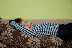 Cute boy on a sofa. Portrait of cute boy on a sofa Stock Image