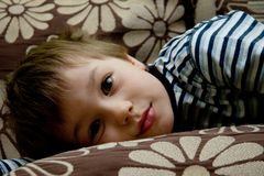 Cute boy on a sofa. Portrait of cute boy on a sofa Stock Photo
