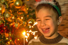 Cute boy with sparklers Stock Photography