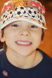 Cute Boy with Sports Hat royalty free stock image