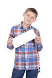 Cute boy standing with empty horizontal blank Stock Images