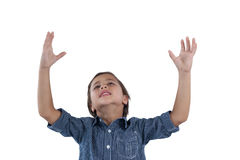Cute boy standing with hands raised Royalty Free Stock Photography