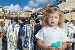 Cute boy stands at Western Wall Stock Photo