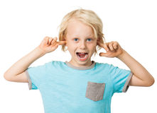 Cute boy sticking fingers in ears Royalty Free Stock Photography