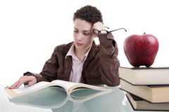 Cute boy studying and thinking Stock Images
