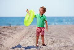 Cute boy on the summer beach Stock Image