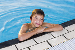 Cute boy swimming in water. Activities on the pool. Cute boys swimming and playing in water in swimming pool Royalty Free Stock Photography
