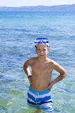 Cute boy swimming in water Royalty Free Stock Photography