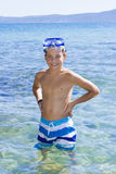 Cute boy swimming in water Stock Images