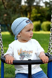 Cute  boy on a swing Stock Photos