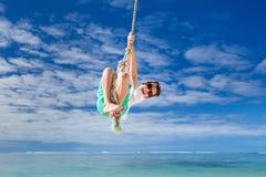 Cute boy swinging Stock Photos