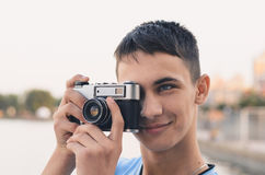 Cute boy teenager with vintage rangefinder camera. Close-up Photo Royalty Free Stock Photos