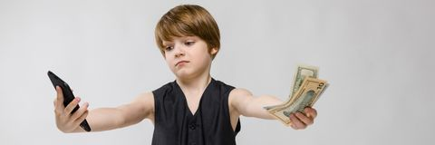 Cute boy with telephone and cash royalty free stock image
