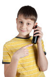 Cute boy with telephone in his hands Royalty Free Stock Photography