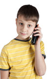 Cute boy with telephone in his hands Royalty Free Stock Photos