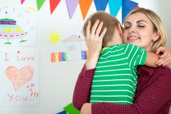 Cute boy tenderly hugging his beloved mother. Mothers Day Stock Photo