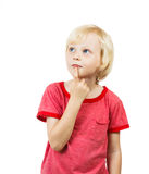 Cute boy thinking. A cute young boy thinking and looking at copyspace Royalty Free Stock Image