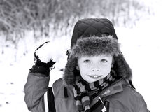 Cute boy throwing a snowball. Cute little boy about to throw a snowball Royalty Free Stock Images