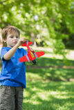 Cute boy with toy aeroplane at park Stock Photography