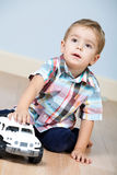 Cute boy with toy car Stock Photo