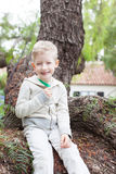 Cute boy at the tree Stock Images