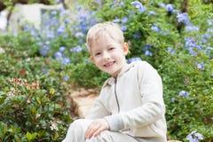 Cute boy at the tree royalty free stock photos