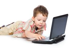 A cute boy is typing on a laptop Stock Photography