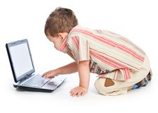 A cute boy is typing on a laptop Royalty Free Stock Photo