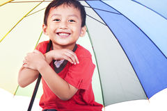 Cute boy under umbrella Royalty Free Stock Photos