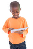 Cute boy using his tablet pc Stock Photo
