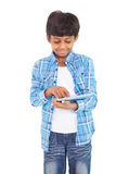 Cute boy using his tablet pc Royalty Free Stock Photos