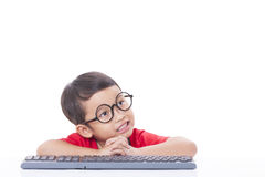 Cute Boy using a keyboard Royalty Free Stock Images