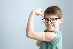 Free Cute Boy Vaccinated Against Coronavirus Infection. Vaccination Against Covid-19. Sputnik-V. Copy Space Stock Images - 217430654