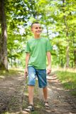 Cute boy walking through the forest Royalty Free Stock Image